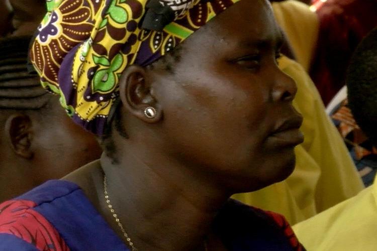 A Kenyan woman watching intently